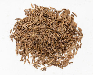 Fototapeta top view of pile of caraway seeds close up on gray obraz