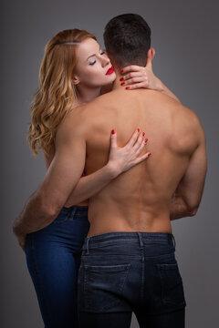 Sensual woman embracing boyfreind