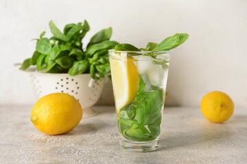 Obraz Glass of lemonade with basil on light background - fototapety do salonu