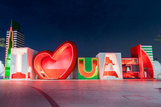 24 February 2021, Dubai, UAE: I love United Arab Emirates caption on promenade of Dubai Creek Harbour