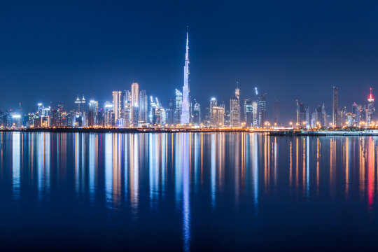Panoramic view of the Burj Khalifa and other skyscrapers in the financial center of Dubai in the UAE with reflections in the waters of the Creek Channel