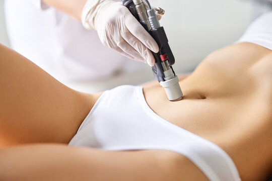 Woman getting laser skin care treatment in clinic