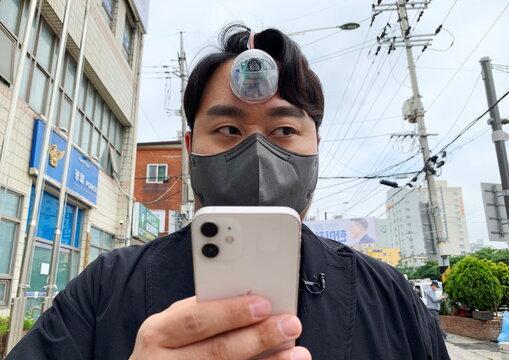 "South Korean industrial designer Min-wook showcases the robotic eye, ""The Third Eye"", in Seoul"