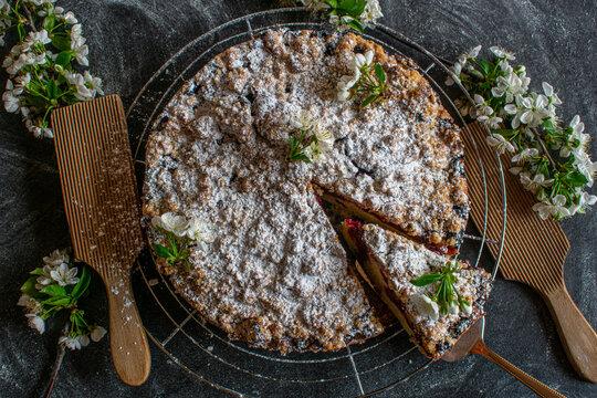 fresh cheery crumble cake on dark table