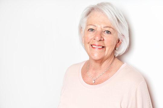 nice portrait of a retired senior woman on studio background
