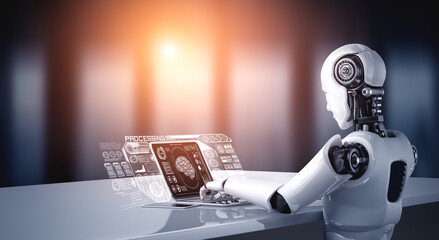 Fototapeta Robot humanoid use laptop and sit at table for big data analytic using AI thinking brain , artificial intelligence and machine learning process for the 4th fourth industrial revolution . 3D rendering. obraz