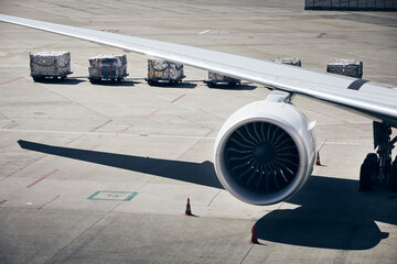 Loading of cargo containers to plane at airport. Ground handling preparing airplane before flight...