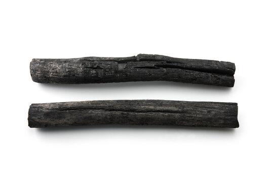 Two natural wood charcoal Isolated on white. Kishu binchotan, japanese traditional white charcoal or hard wood charcoal, isolated on white background.