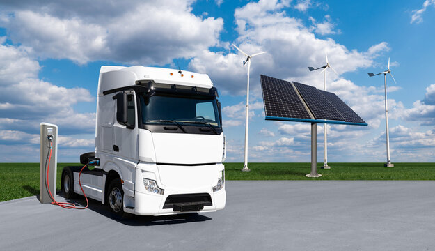 Electric truck with charging station on a background of solar panels and wind turbines. Concept