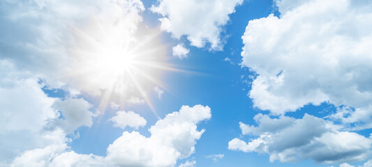Obraz Blue sky, cloudscae background banner panorama , with clouds and sun reflection / sunshine sunbeams - fototapety do salonu