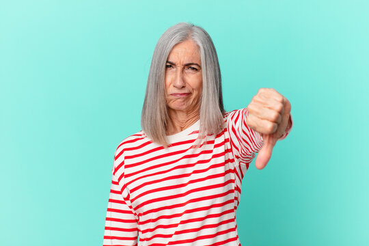 middle age white hair woman feeling cross,showing thumbs down