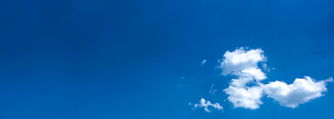 White cloud on the blue sky. Wide background, header