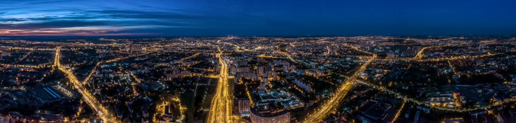 Obraz aerial panoramic cityscape with illuminated streets and buildings at night. Minsk, Belarus. - fototapety do salonu