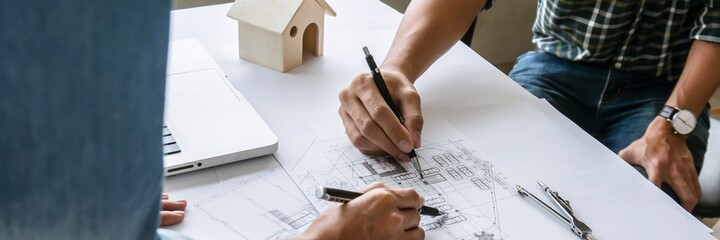 Obraz Architecture drawing on architectural project business architecture building construction Colleagues interior designer Corporate Planning Design on blueprint Teamwork with compasses. - fototapety do salonu