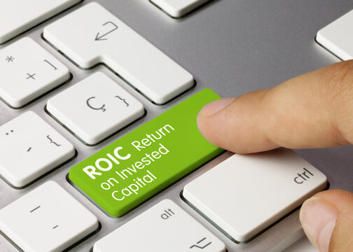 ROIC Return on Invested Capital - Inscription on Green Keyboard Key.
