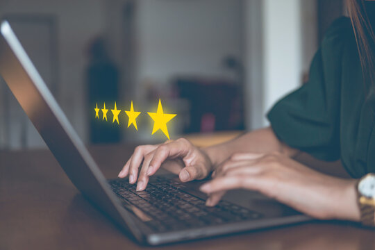 5star concept of testimonial and review, people use computer laptop for review rating online.