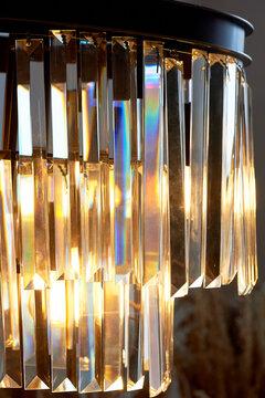 Retro floor lamp with glass pendants. macro. Yellow warm light. Interior design