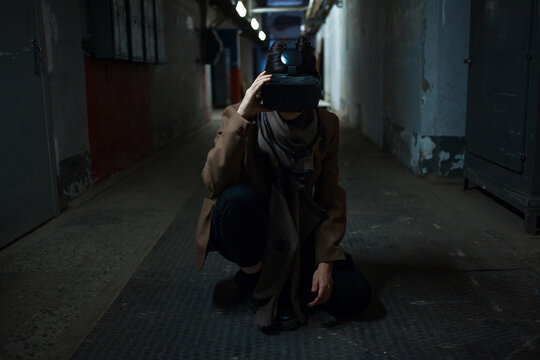 virtual reality player in a shabby environment, a grim future with technology