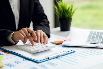 Businesswoman hands hold documents with financial statistic stock photo,discussion and analysis data the charts and graphs.Finance, Market research reports and income statistics and Accounting concept - fototapety na wymiar