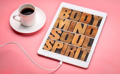 Fototapeta body, mind, soul and spirit - wellness and harmony concept - text t in letterpress wood type on a digital tablet with cup of coffee obraz