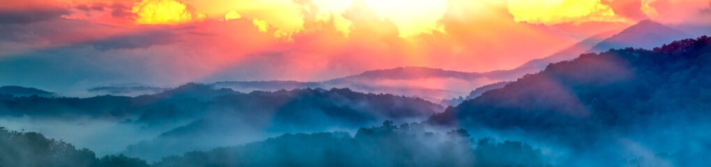 Panoramic View Of Smoky Mountain Ridges With Fog And Light-rays