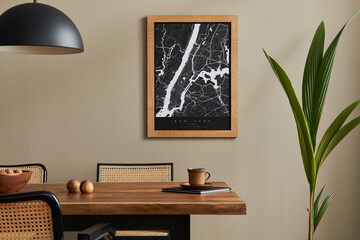 Stylish dining room interior with mock up poster map, wooden walnut table, design chairs, cup of...