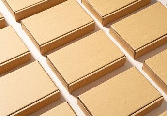 Obraz Cardboard boxes placed on a beige background. - fototapety do salonu