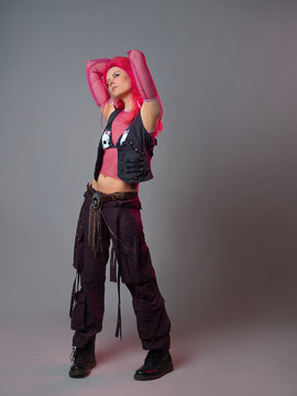 Futuristic fashion, a young bright and attractive woman with pink hair,
