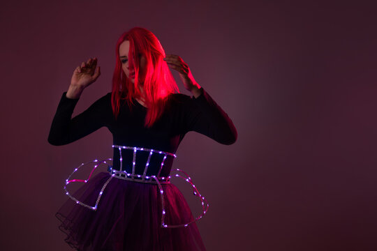 Light show, suit with LEDs. Young beautiful woman in a luminous suit