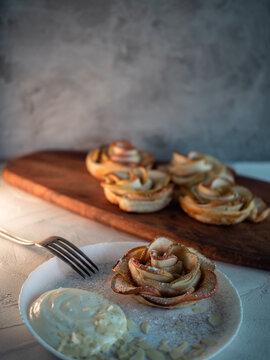 Apple roses, apple buns, serving with whipped cream and almond petals,