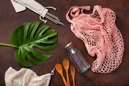 zero waste eco friendly concept. reusable cotton bag, stainless steel drinking staw, glass jar, wooden cutlery