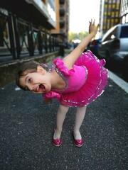Fototapeta Portrait Of Happy Girl Bending On Road obraz