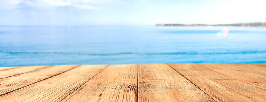 A wooden table on a beautiful sunny holiday day with a charming sea landscape