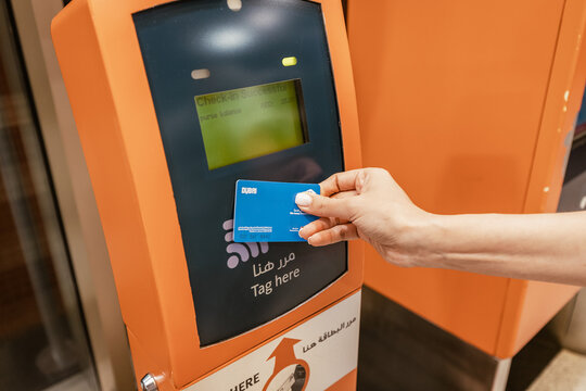 25 February 2021, Dubai, UAE: The passenger applies a contactless smart transport card RTA to pay for travel on the tram or metro in Dubai
