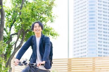 Fototapeta 自転車に乗る男性 obraz