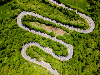 Obraz Mountain Pass Winding Road in Woodlands. Drone View - fototapety do salonu