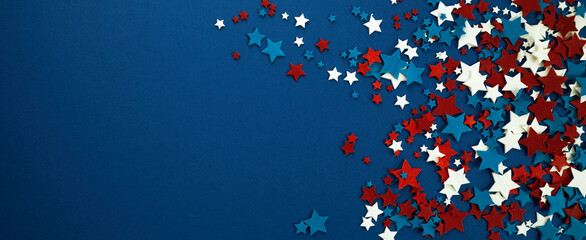 Fototapeta 4th of July American Independence Day stars decorations on blue background. Flat lay, top view. obraz