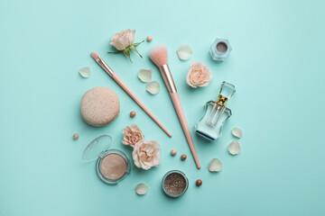 Fototapeta Flat lay composition with makeup products, roses and macaron on turquoise background obraz