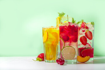 Iced refreshing drink. Bar and caffee beverage menu background. Set of various cold summer cocktails - peach tea, lemonade, mojito, cherry mocktail, with frruits on colorful bright background