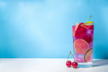 Obraz Cherry cocktail on color pink background - fototapety do salonu