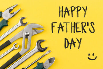 Obraz Work tools on bright yellow background with inscription: