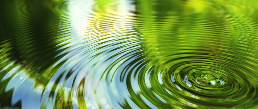Ring waves of a water drop with nature reflections