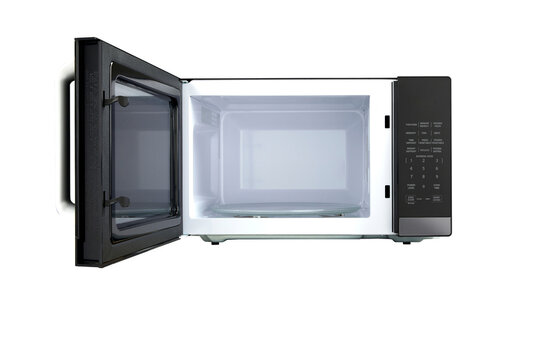 Black modern opened microwave isolated on a white background