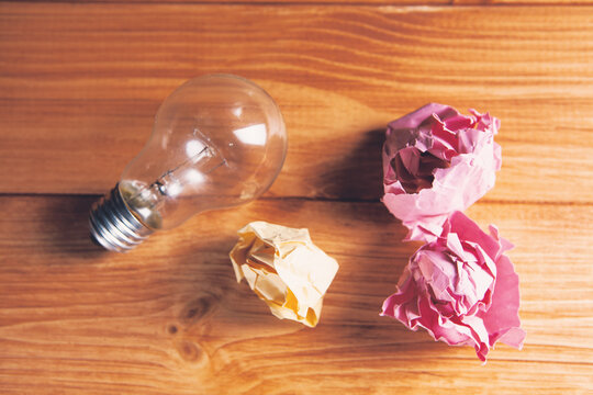 light bulb and crumpled papers