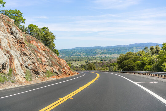 Empty highway going through the Sierra Foothills; Calaveras County, California