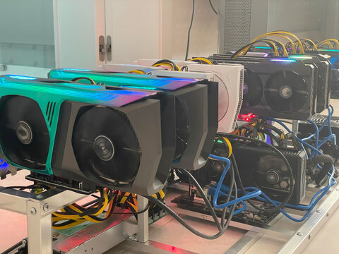 Row of bitcoin miners set up on the wired shelfs. Device for mining crypto currency. Mining cryptocurrency. Bitcoin farm. Machines for mining cryptocurrency bitcoin. Electronic device at day.