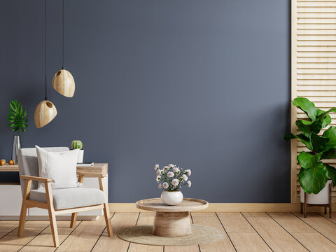 Living room interior room wall mockup in dark tones,gray armchair with wood cabinet.