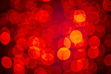 Glitter red and yellow soft-focus lights flashing. Background with natural bokeh defocused sparkle. Decoration at Christmas holiday. Happy new year.