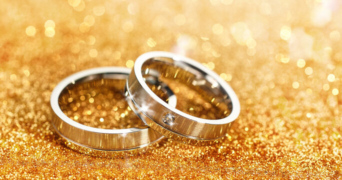 Silver rings on golden background
