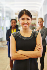 Fototapeta Portrait Of Smiling Confident Businesswoman Standing With Colleagues At Office obraz